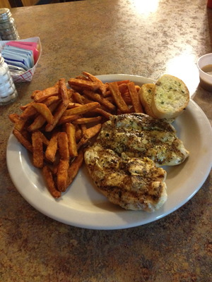 Charbroiled chicken with sweet potato fries